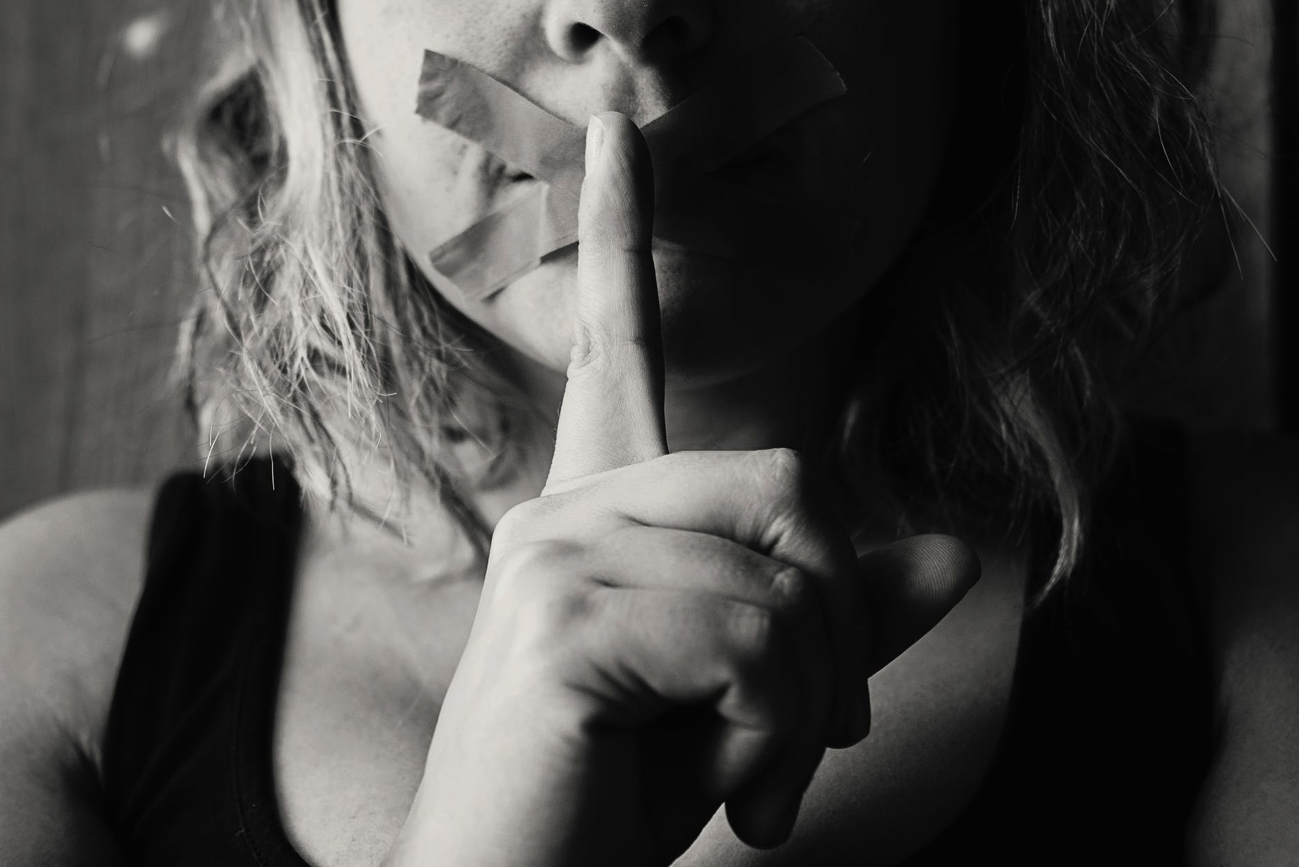 woman placing her finger between her lips